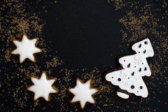 Black background with figured gingerbread, closeup. Top view Stock Photo