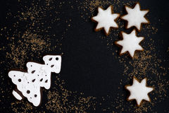 Black background with figured gingerbread, top view. Horizontal Stock Image