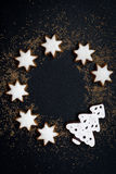 Black background with figured gingerbread, vertical. Top view Royalty Free Stock Photo