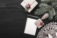 On a black background, a fir tree with cone and decorative objects. Royalty Free Stock Images