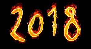 On Black Background 2018 Fire Number/. Happy New Year 2018 with flaming fire burn and the black background isolated Royalty Free Stock Images