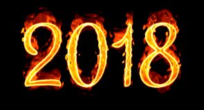 On Black Background 2018 Fire Number/. Happy New Year 2018 with flaming fire burn and the black background isolated Royalty Free Stock Image