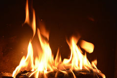 Black background with Fire place and moving flames Royalty Free Stock Photo