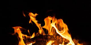 Black background flame shape Royalty Free Stock Image