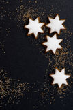 Black background with a gingerbread in the form of stars Stock Images