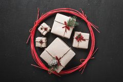 Black background. Modern style. Original gifts for winter holidays. Space for parties for Christmas and New Year messages. Xmas and Happy New Year composition Royalty Free Stock Image