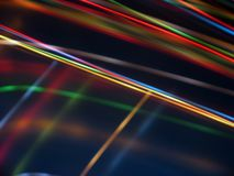 Black background with multicolored luminous lines Stock Images
