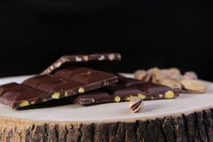 Black Background Nuts and Chocolate. Ripe Nuts and Chocolate Concept and Decoration Stock Images