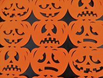 Black background with orange pumpkin heads stock photo
