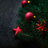 Black background with pine and Christmas toys. New Year Card w Royalty Free Stock Photography