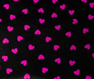 Black background with pink hearts Royalty Free Stock Photo