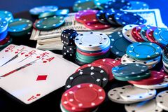 Black background with poker chips  cards, dollars Stock Photography