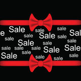 Black background with red ribbon and bow with the words sale .Sale Inscription. Stock Image