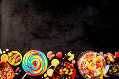 Black background with row of confections at bottom Stock Photography