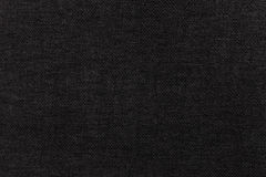 Black background from textile material. Fabric with natural texture. Backdrop. Royalty Free Stock Photos