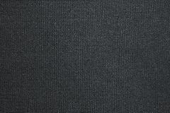 Black background of texture synthetic fabric Stock Images