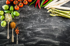 Black backgroung with vegetables. Herbs and spices royalty free stock photos