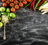 Black backgroung with vegetables. Herbs and spices stock images