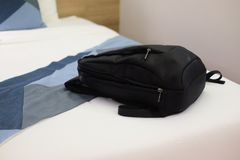 Black backpack bag on bed. Black backpack bag in bed room, ready for vacation royalty free stock images
