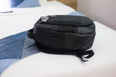 Black backpack bag on bed. Black backpack bag in bed room, ready for vacation stock photos
