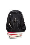 Black backpack with books on white Royalty Free Stock Photo