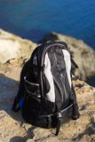 Black backpack on the rock peak Royalty Free Stock Photography
