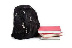 Black backpack with text books on white Royalty Free Stock Photos