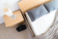 Black Bag on Floor Beside Unmade Bed in Hotel Room Royalty Free Stock Photos