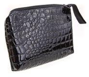 Black bag. Black leatherette pencil case on white background Stock Image