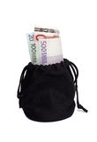 Black bag with money Royalty Free Stock Photo
