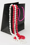 Black bag with pearls Royalty Free Stock Photos