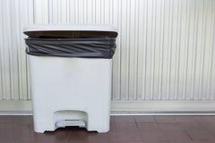 Black bag plastic in white trashcan Royalty Free Stock Photo