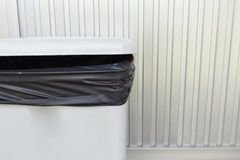 Black bag plastic in white trashcan Royalty Free Stock Photography