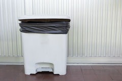 Black bag plastic in white trashcan Royalty Free Stock Images