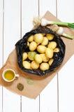 Black bag with potatoes Stock Image