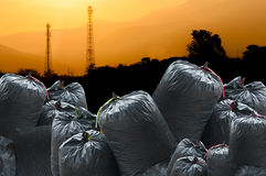 Black bag of rubbish isolated on industry landscape background Royalty Free Stock Images