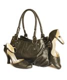 Black bag with shoes isolated on white. (with clipping path Royalty Free Stock Photography