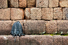 Black  bag in stone wall Royalty Free Stock Photos