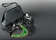 Black bag and woman accessories Stock Images