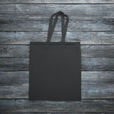 Black bag on the wooden table Royalty Free Stock Photography
