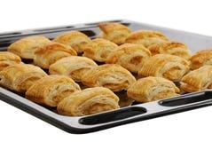 Black baking pan with fresh baked bourekas Royalty Free Stock Photos
