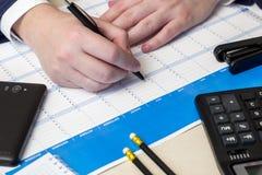 Black ball-point pen, calculator Stock Photo