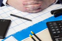 Black ball-point pen, calculator Stock Photos