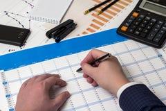 Black ball-point pen, calculator Royalty Free Stock Photography