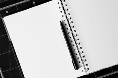 Black Ball-point Pen on White Notebook Royalty Free Stock Photos