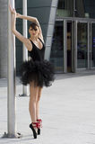 Black ballerina near pole Royalty Free Stock Photo
