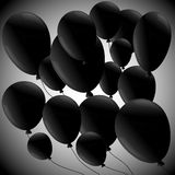 Black balloons  on grey background Stock Photos