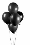 Black balloons. Group of black balloons with silver string isolated on white Royalty Free Stock Photo