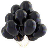 Black balloons happy birthday party decoration dark glossy Stock Photography