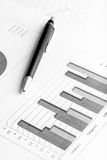 Black ballpoint next to a printed 3d column chart Royalty Free Stock Image